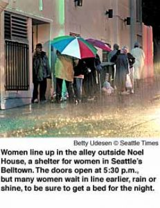 Women line up in the alley that leads to Noel House, where the doors will open at 5:30pm. They say they brave the line, even in the rain, to be sure to get a bed for the night.