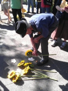 Walt Nicks placing flowers