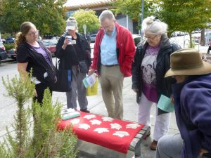 Nine Leaves prepared for dedication at Ballard Commons