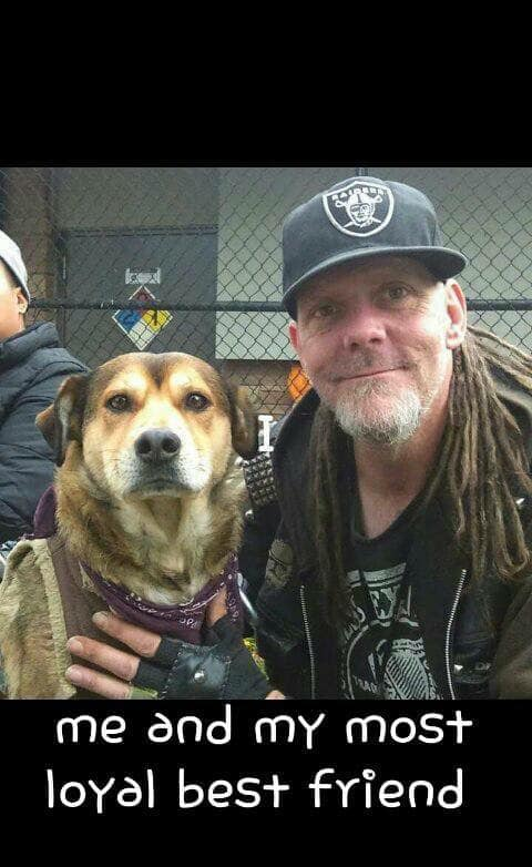 "Johnee with his dog, captioned ""me and my most loyal best friend"""